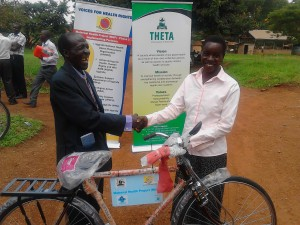 Mzee reveals his joy in a very warm smile as he recives hi bicycle at the sub-county Offices in Kiziranfumbi Hoima district