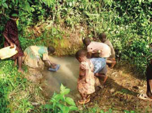 Children fetching water for domestic use from unprotected water source (Photo by UNICEF)